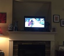 q how can i decorate a huge recessed tv opening over my mantle
