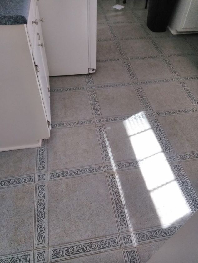 q what can i put over a linoleum floor short of pulling it up