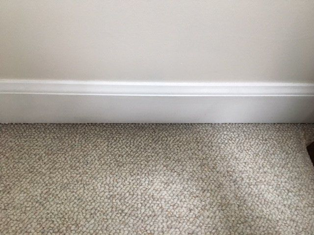 q how can you remove sooty stain from carpet around floor molding