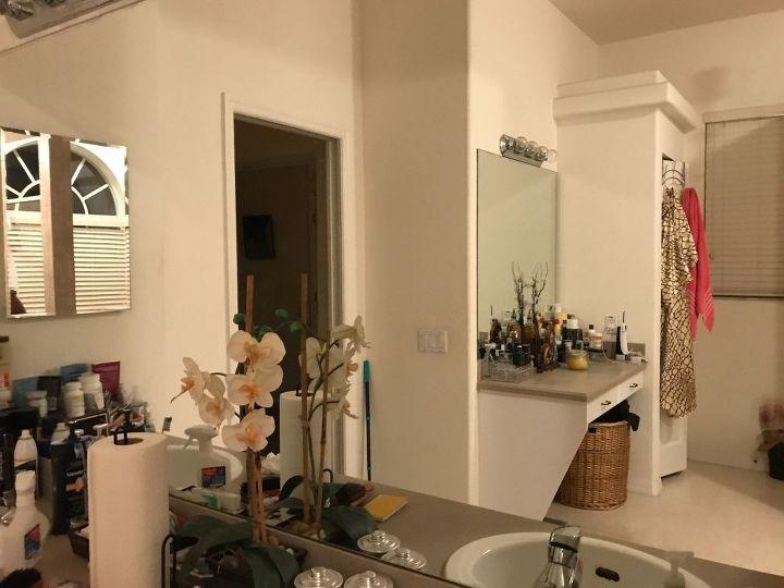 q taking down a large bathroom mirror