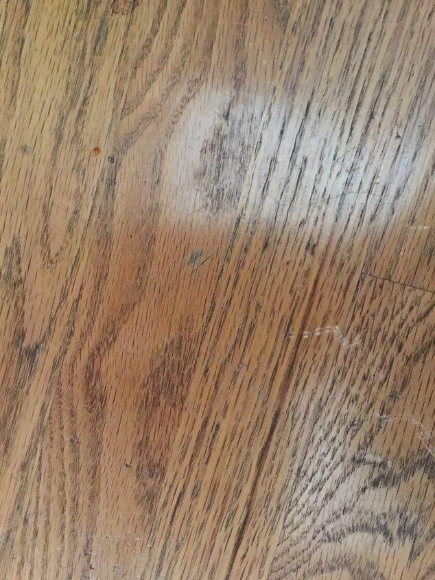 q heel imprints on wooden floors