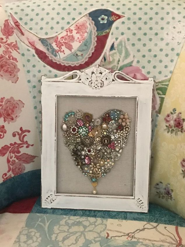 create a pretty framed heart for valentines day using old jewelry