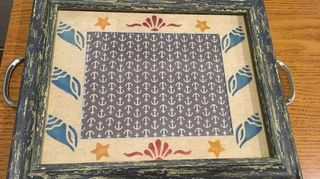 , The top is a nice frame I just loved the finish on it I duplicated it on the bottom piece of plywood by painting base color using crackle top color and stain Anchor material was mod podged mat was stenciled