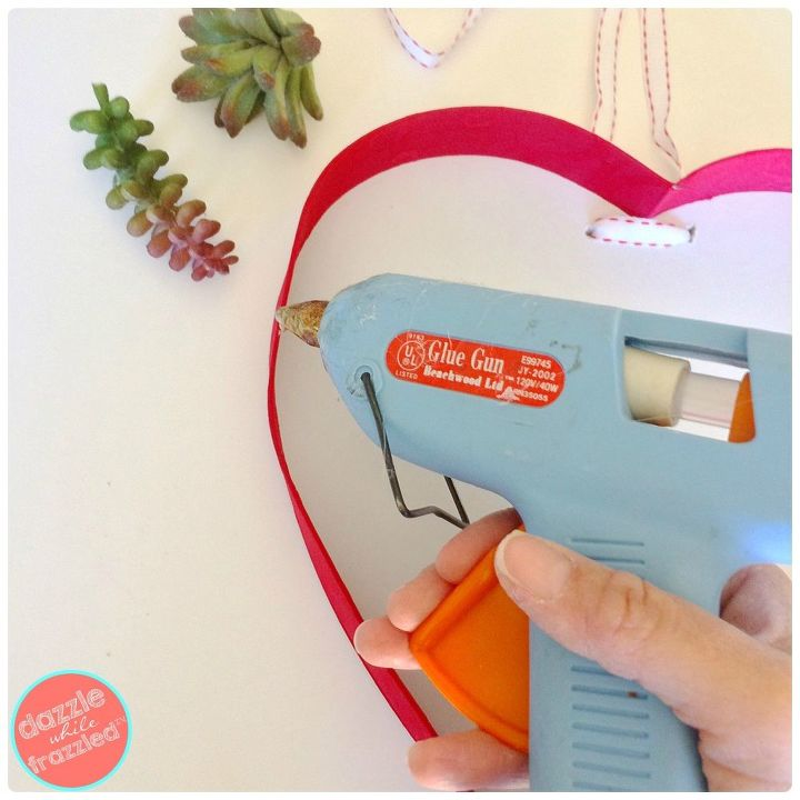 Use glue to secure top of heart box.
