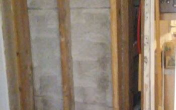 How do I make a storage unit with shelves between wall studs