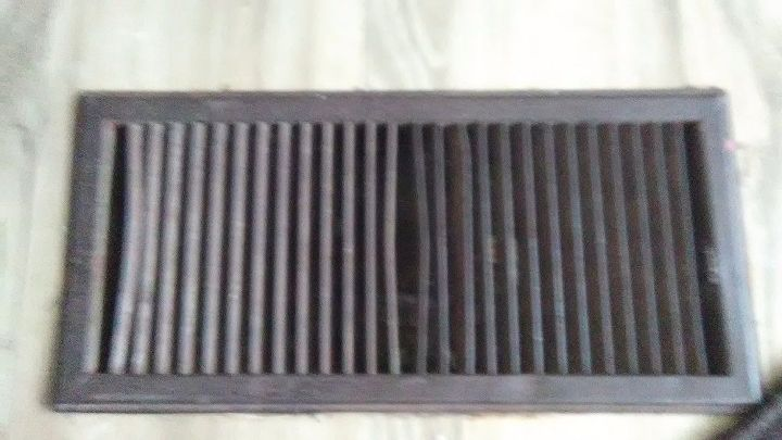 q i need some ideas on how to cover up old floor registers thanks
