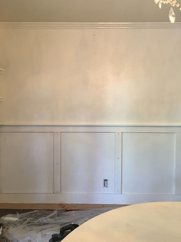 wainscot wall with a picture ledge