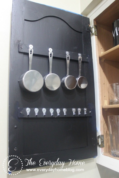 s 15 amazing things you can do with paint stirrers, Measuring Cup Organization