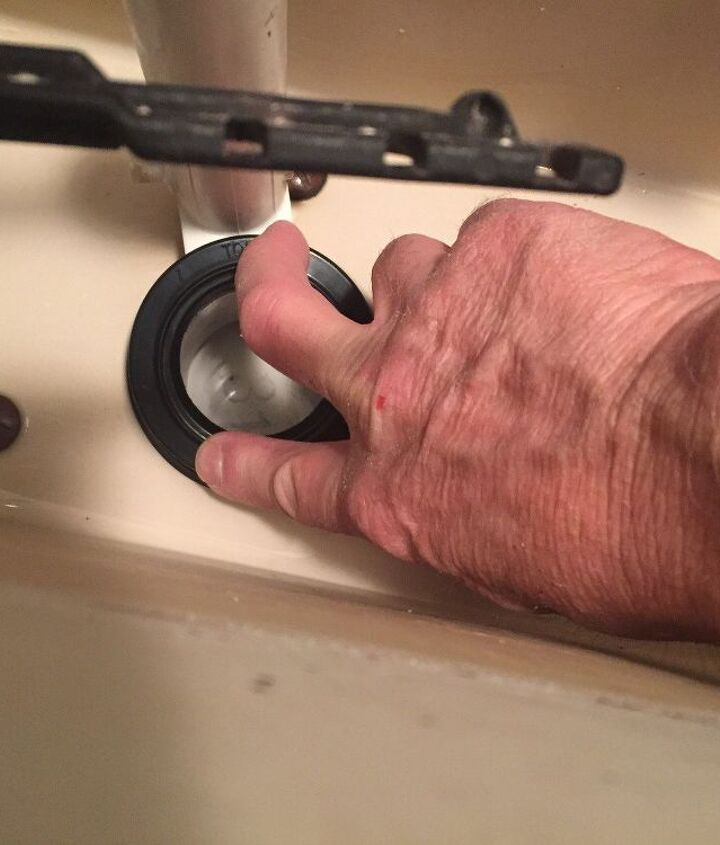 Place new seat on top of flush valve