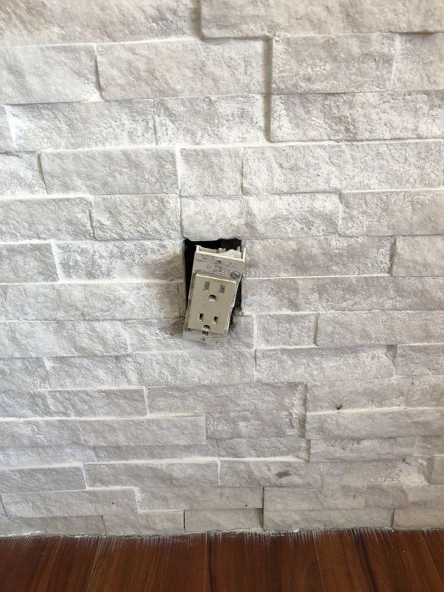 q electric outlets on stone wall