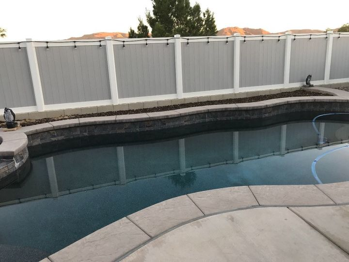 q any ideas for landscaping behind our pool no plants in the ground