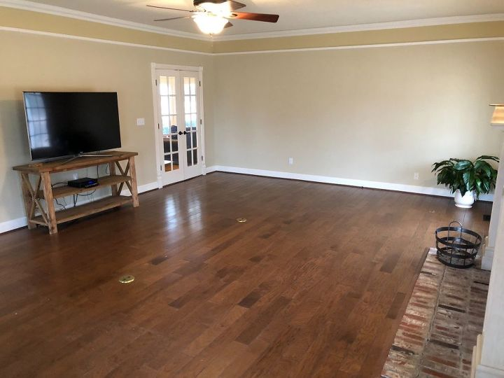 q help me design and furnish this long living room