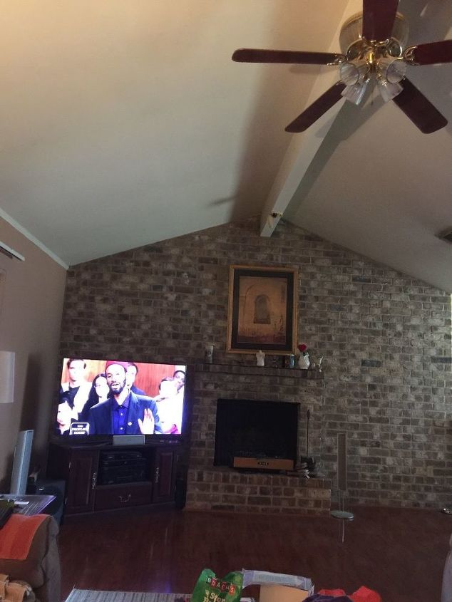q i have a brick wall with fireplace how can i make it more updated