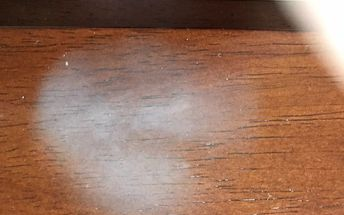 q how to remove wax stain from a hot cup of coffee placed on table