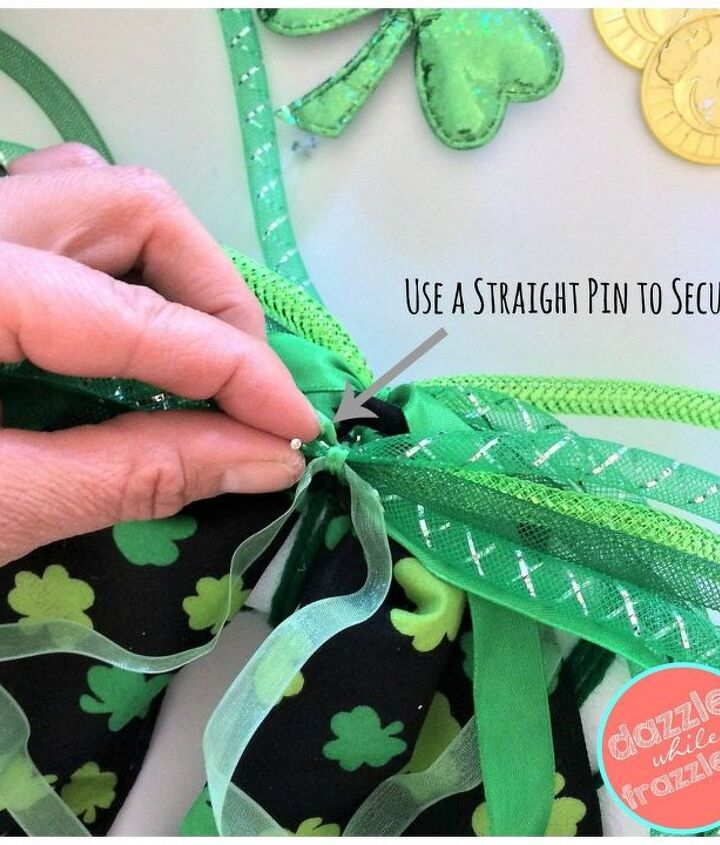 Use straight pins to secure items to wreath.