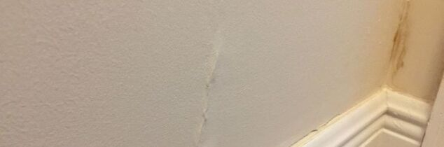 q how to fixed water damage raised section of wall