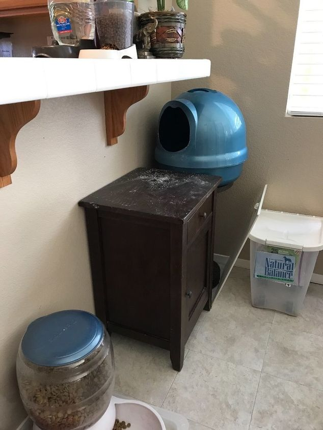 q how do you hide your cat s litter box where your dogs can t get in