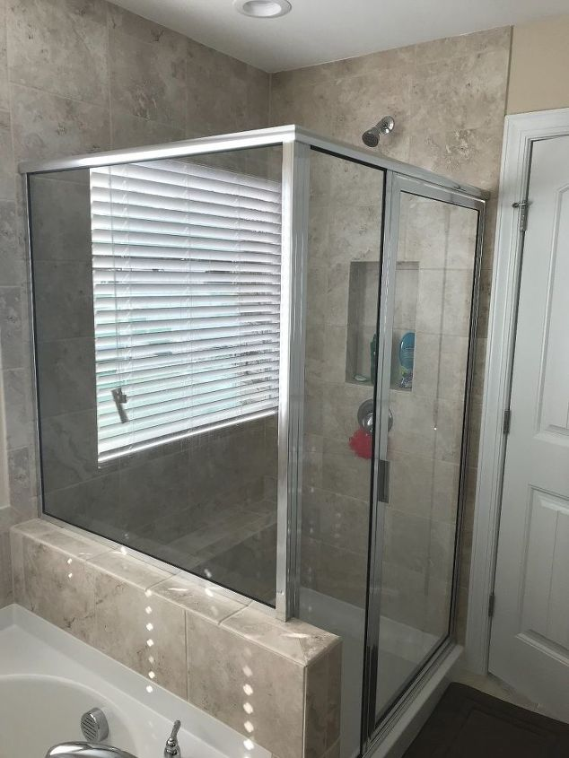 q what s the best way to clean the glass shower door and walls in my n