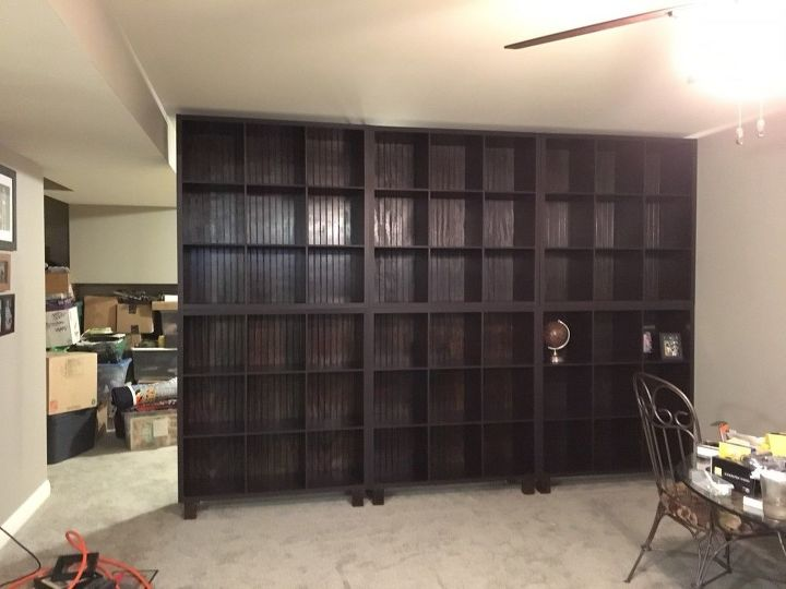 a wall of shelves using store bought shelf organizers