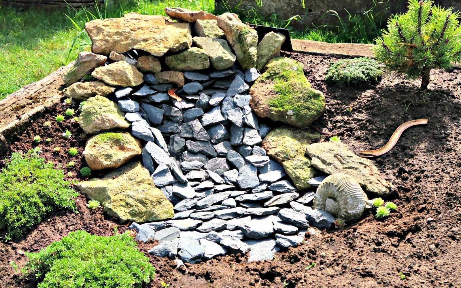 s upgrade your backyard with these 30 clever ideas, Build a solar powered waterfall
