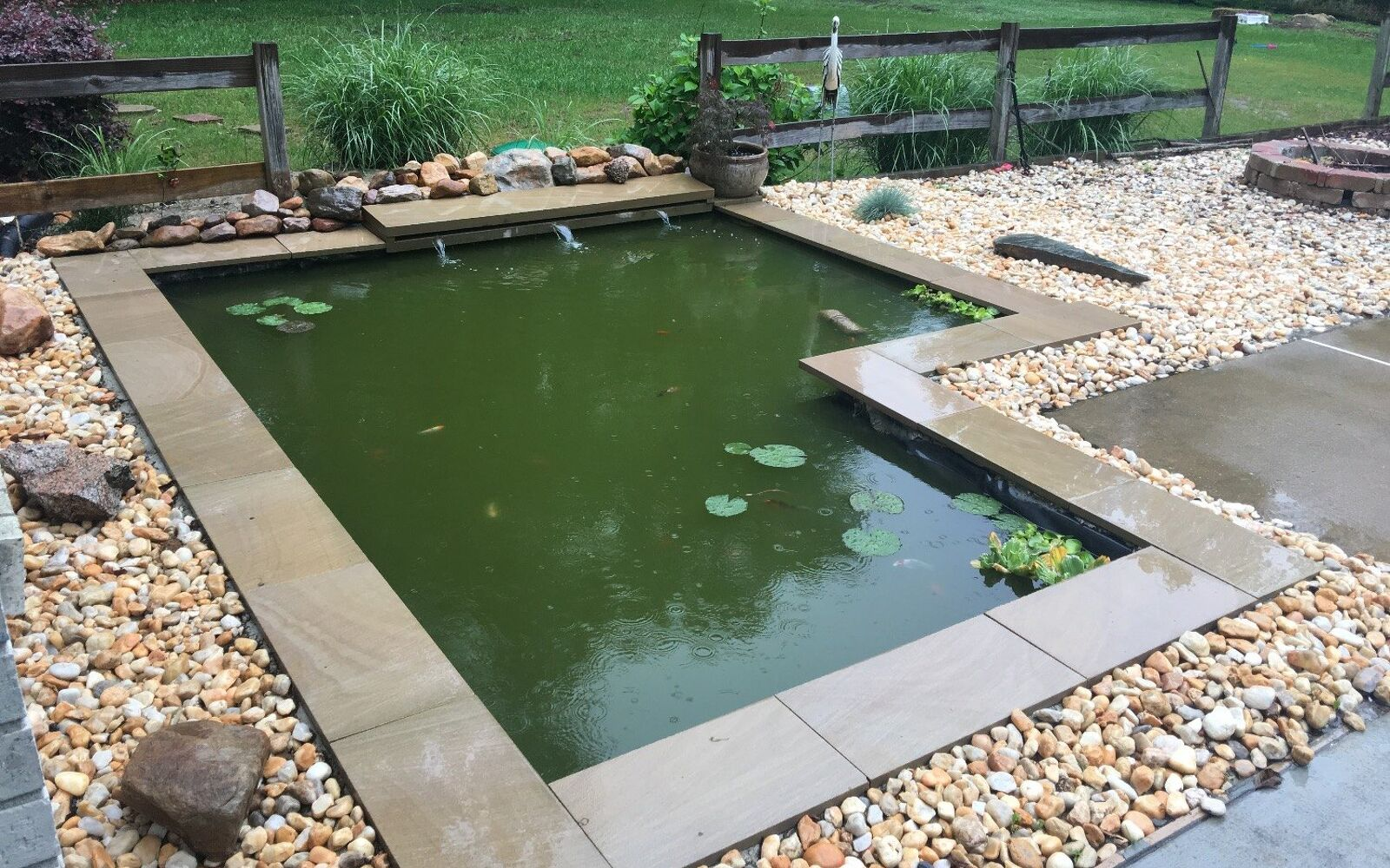 s upgrade your backyard with these 30 clever ideas, Add a modern koi pond on a budget