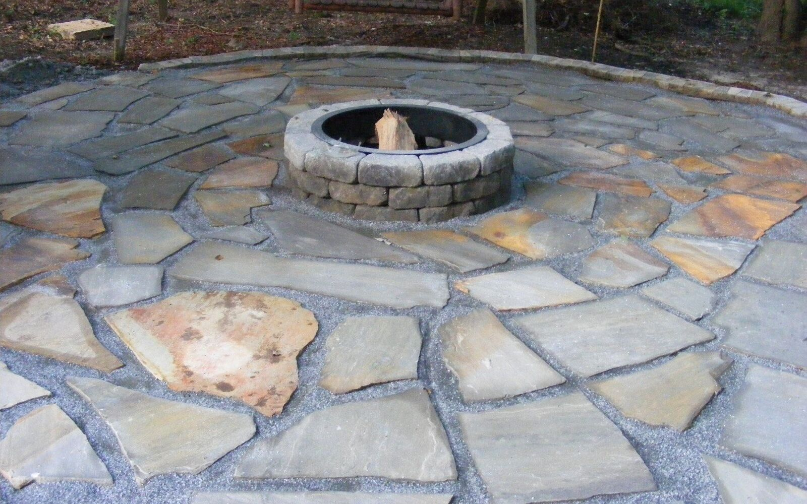 s upgrade your backyard with these 30 clever ideas, Decorate your patio with a flagstone fire pit