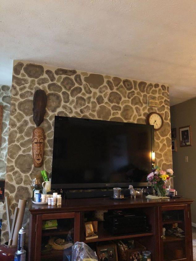 q decorating around a large flatscreen tv