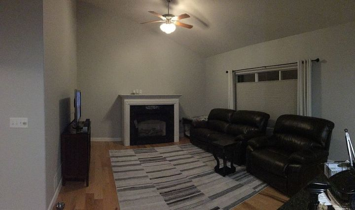 q need advice on how to decorate walls that have a high angled ceiling