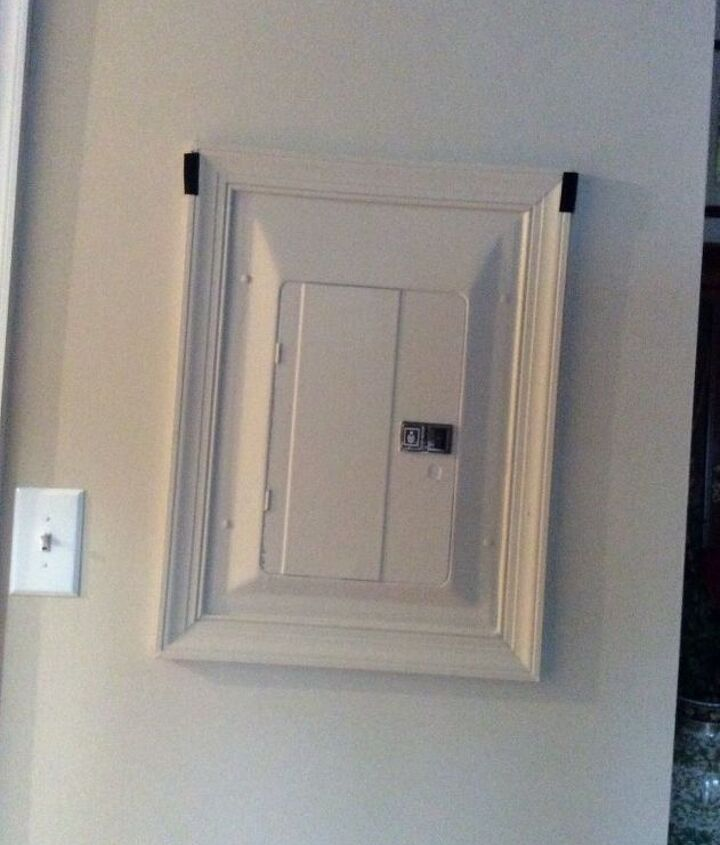 q i need something to cover the unsightly breaker box in living room