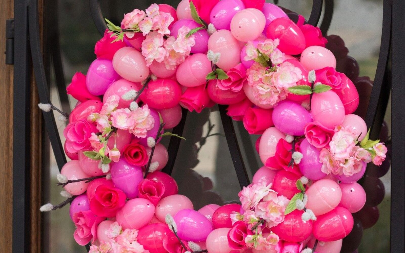 s the cutest ways to decorate your front porch for easter, Gorgeous Floral Easter Egg Wreath
