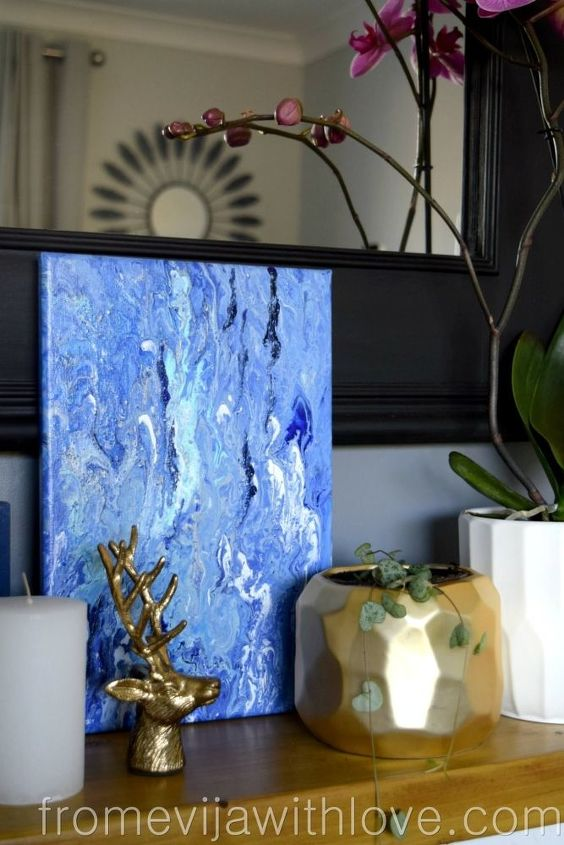 create a unique piece of art using acrylic pouring technique