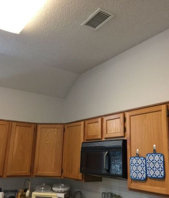 q how would you decorate above my kitchen cabinets
