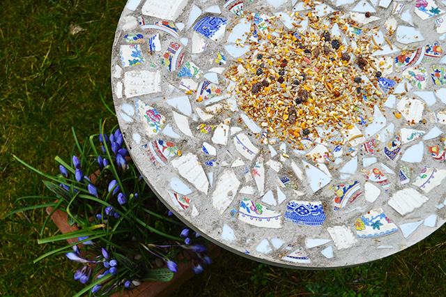 s 18 adorable bird feeders you ll want to make right now, Make a mosaic bird feeding table