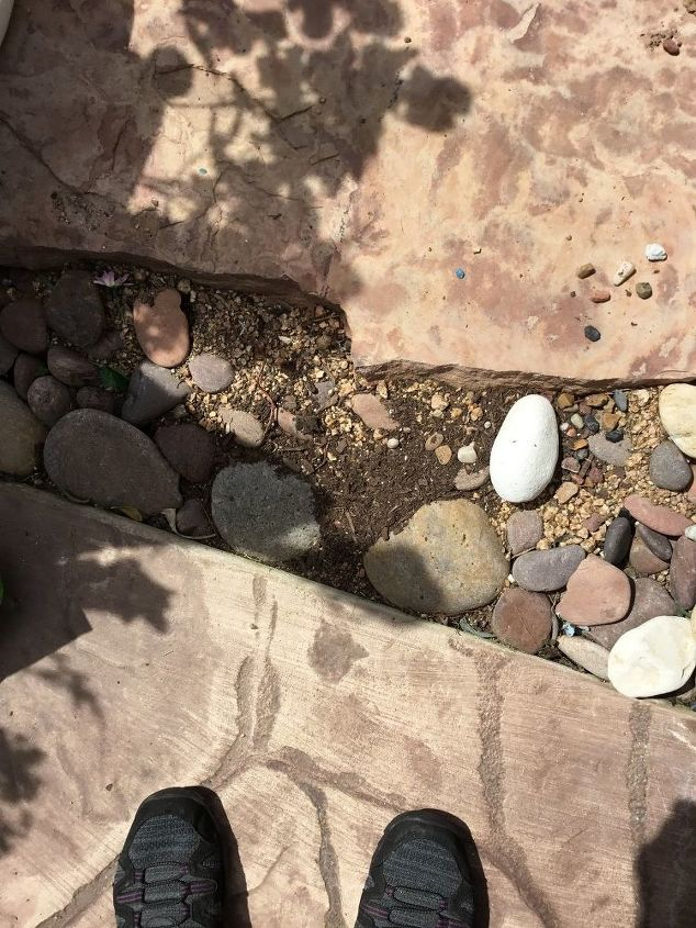 q what would be the best way to fix my flagstone mess economically