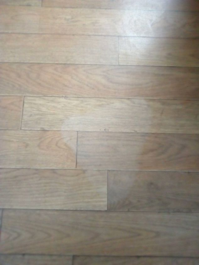 Q I Burnt My Laminate Floor With A Steamer It S Left White Mark