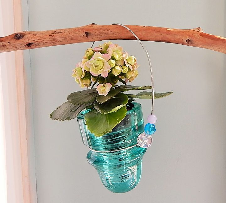 s check out these adorable container garden ideas to copy this spring, Insulator Turned Planter