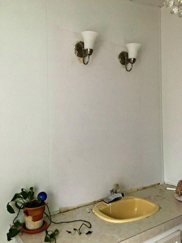 remove a bathroom mirror