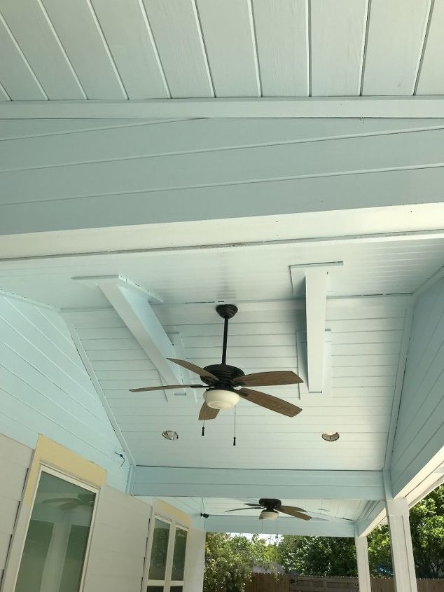 chalk painting backyard patio ceiling and back of the house