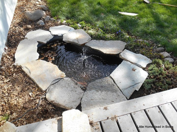 s 15 totally doable makeover ideas you can finish in one day, Lay down flagstone to jazz up your pond