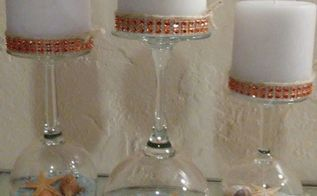 wine glasses turned into candle holders with candle sand shells