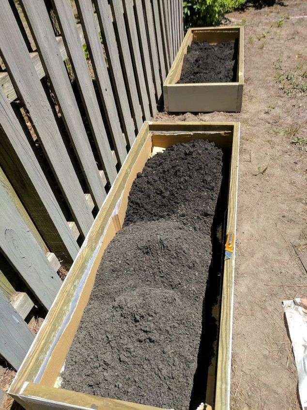Filling the beds with topsoil
