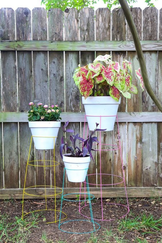 s 15 unconventional ways to use a tomato cage, Use them as colorful plant stands