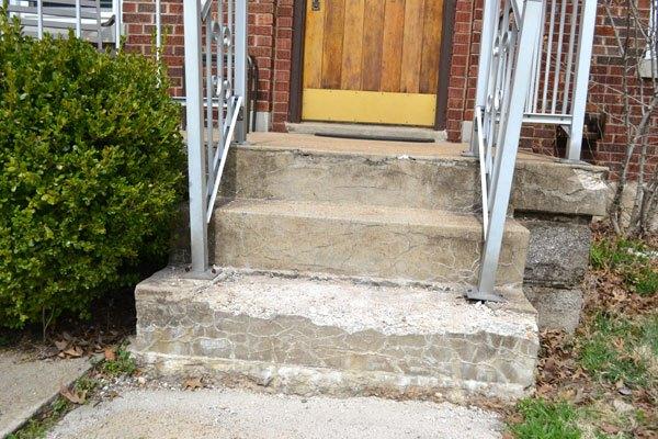 q covering an ugly concrete porch