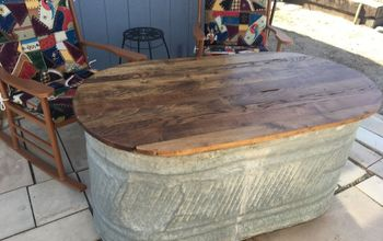 old water trough to a patio storage and table