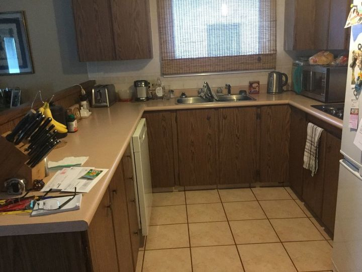 q cheapest way to upgrade a kitchen cabinets