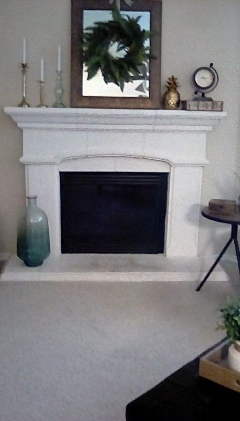q i need ideas on how to update this builder grade fireplace