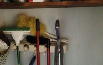 turning a small coat closet into a useful broom utility closet