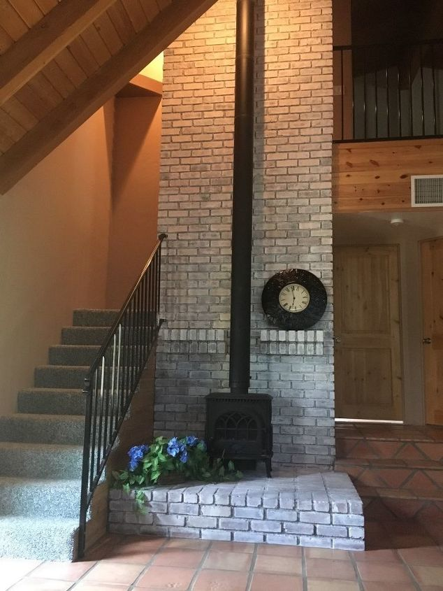 q any decorating ideas for this tall brick fireplace