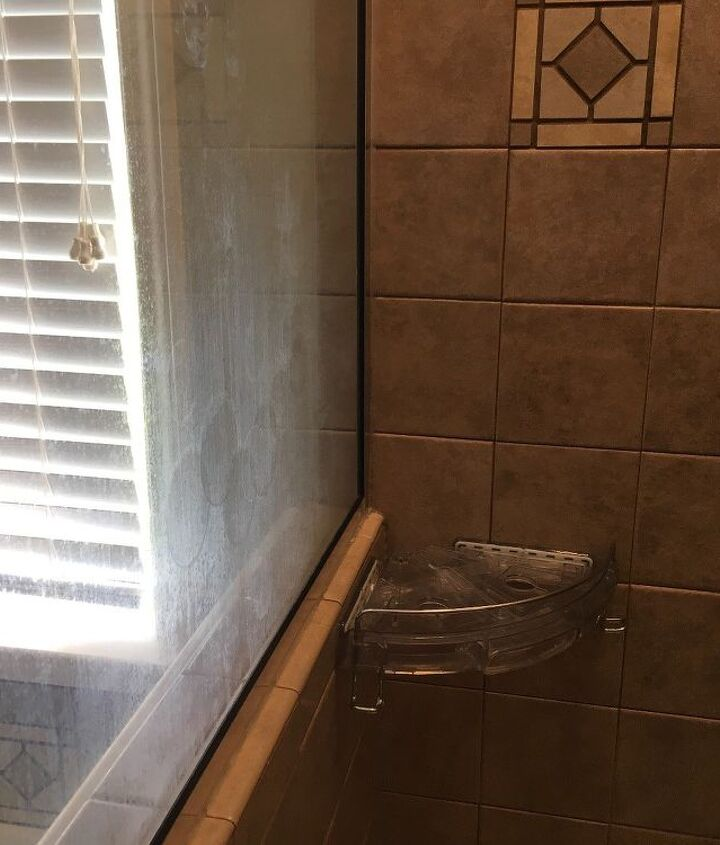q how to remove soap scum on glass shower that has been there for years