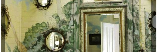 q painted murals on bathroom walls and glass shower against them